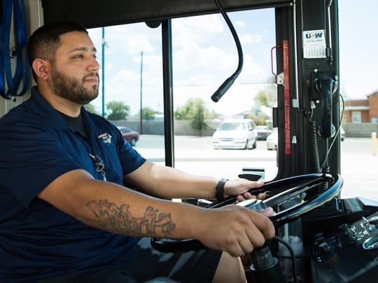 """Roadrunner Transit bus driver Edwardo Tovar prepares to drive passengers, July 22, 2016. The Roadrunner Transit will have changed bus routes starting Monday July 21, 2016. Edwardo finds the new bus route """"exciting"""" and """"something that needed to be done""""."""