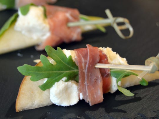 Pears with Goat Cheese and Prosciutto offer a light bite to guests.