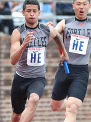 Manny Montoya runs the anchor leg of the 4x100 after