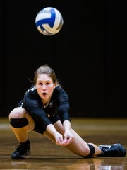 Anderson University sophomore Emily Conard digs for the ball at the Anderson University volleyball game against Mars Hill on Tuesday, October 4, 2016 in Anderson.