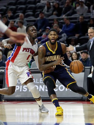 Pacers forward Paul George drives around Pistons guard Reggie Jackson (1) during the second half of the Pistons' 105-90 loss Saturday at the Palace.