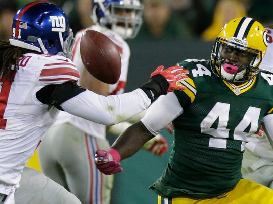 Green Bay Packers running back James Starks (44) loses control of the ball during the fourth quarter of their game  against the New York Giants at Lambeau Field on Oct. 9.