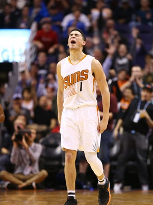 Phoenix Suns' Devin Booker reacts to making a 3-pointer against the Minnesota Timberwolves in the first half on Jan. 24, 2017 in Phoenix, Ariz.