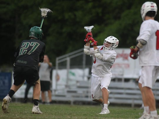 Leon's Shane Shively fires a shot for a goal during a 13-9 win over Lincoln on Tuesday night in a district semifinal.