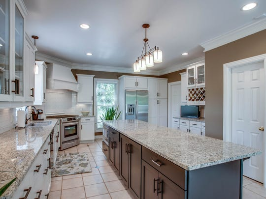 The kitchen features granite, stainless and a huge island.