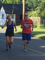 Chambersburg's Delane Balafoutas and Anthony Fisher share a laugh while running with the Chambersburg Beer Runners on June 20.