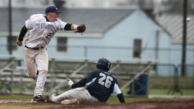 St. Michael's Peter Bocchino (27) misses the throw at third base during a college baseball game last year.