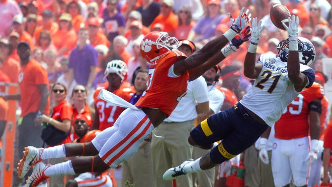 Kent State's Demetrius Monday (21) breaks up a pass intended for Clemson Tigers wide receiver Cornell Powell (17) during the first half at Clemson Memorial Stadium.