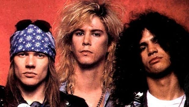 Original Guns N' Roses members (left to right) Axl Rose, Duff McKagen and Slash are expected to reunite in 2016.
