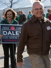 Judge James Daley up for election in April walks in the Oshkosh St. Patrick's Day parade March 14, 2015.