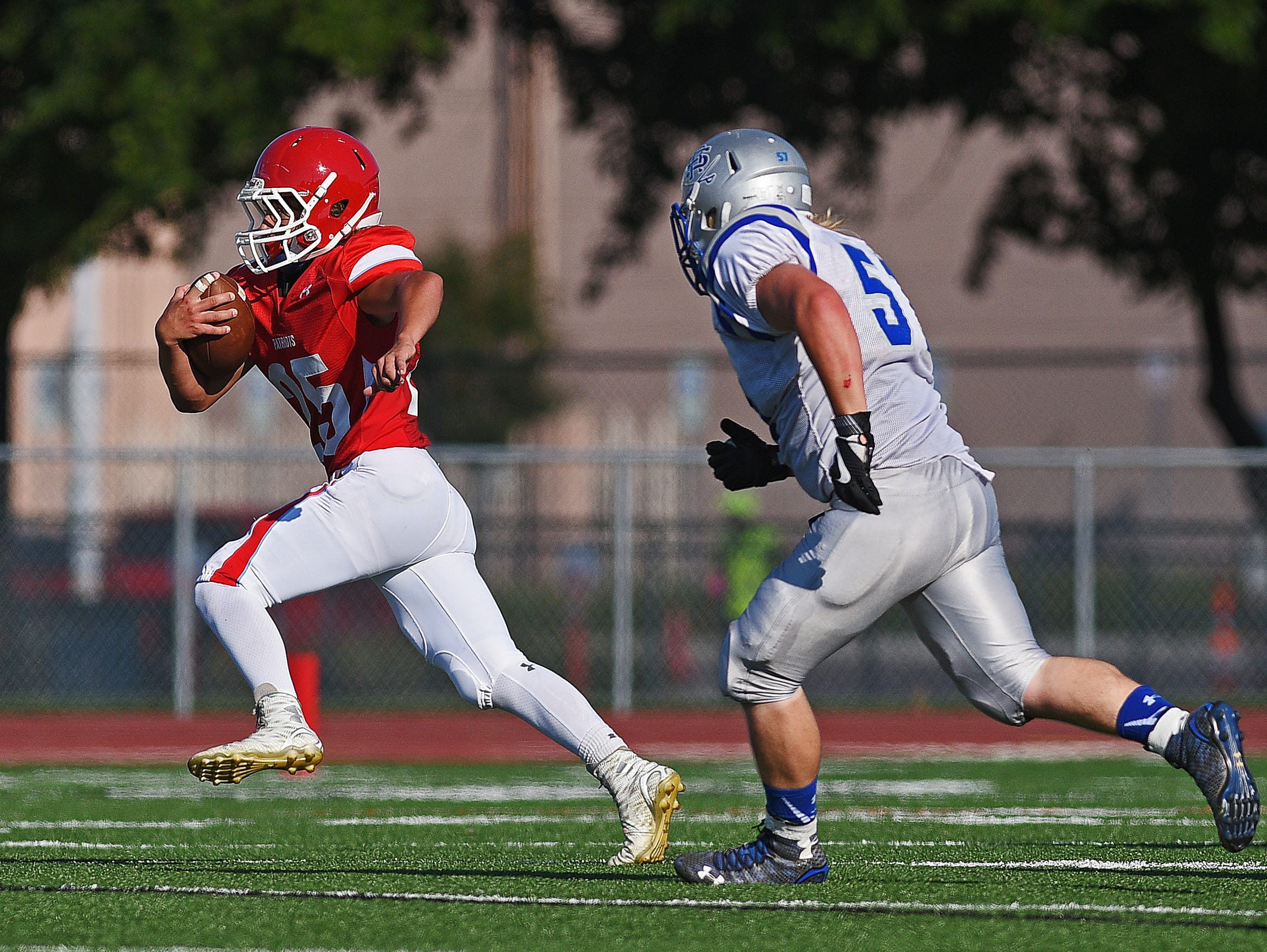 Lincoln's Jayden Julius (25) finds room to run during a game against Rapid City Stevens Saturday, Aug. 27, 2016, at Howard Wood Field in Sioux Falls.