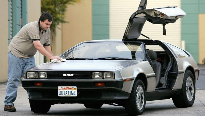 Wayne Gillard polishes up his 1981 DeLorean DMC 12