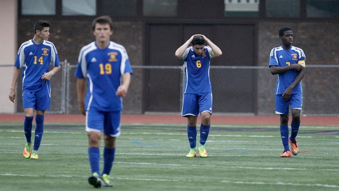 Mahopac players walk off the field after their 2-0 loss to New Rochelle in the boys soccer Class AA first round at New Rochelle High School on Oct. 20.
