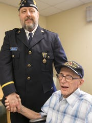 96-year-old World War II veteran Norbert Knappman, shown Friday, May 25, 2018, appreciates, but also doesn't feel deserving, of the honor made available by American Legion Post 141 Adjutant Brian Gillette of riding on the American Legion Post's float in the Memorial Day Parade.