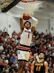 New Albany's Romeo Langford (1) prepares to dunk against Bloomington North on Friday at New Albany High School. Feb. 24, 2017