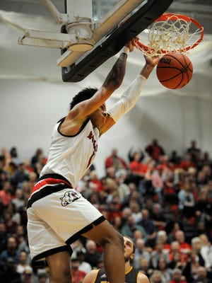 New Albany's Romeo Langford (1) dunks against Bloomington North on Friday at New Albany High School. Feb. 24, 2017