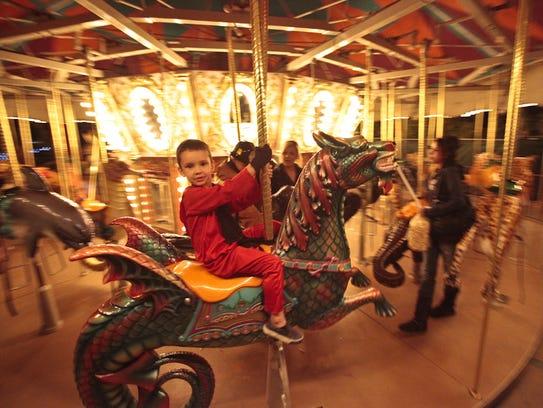 Logan Johnson, 5, of Scottsdale, rides the Phoenix