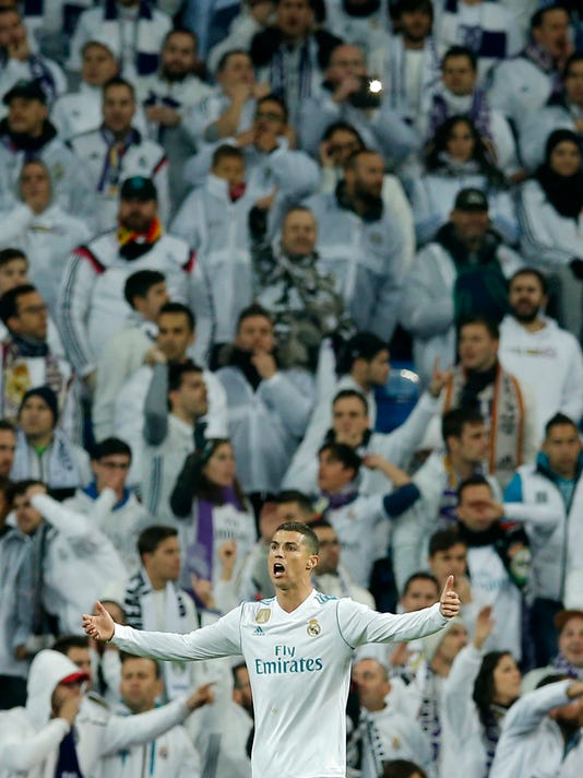 Real Madrid's Cristiano Ronaldo reacts in front of supporters during the Champions League Group H soccer match between Real Madrid and Borussia Dortmund at the Santiago Bernabeu stadium in Madrid, Spain, Wednesday, Dec. 6, 2017. (AP Photo/Paul White)