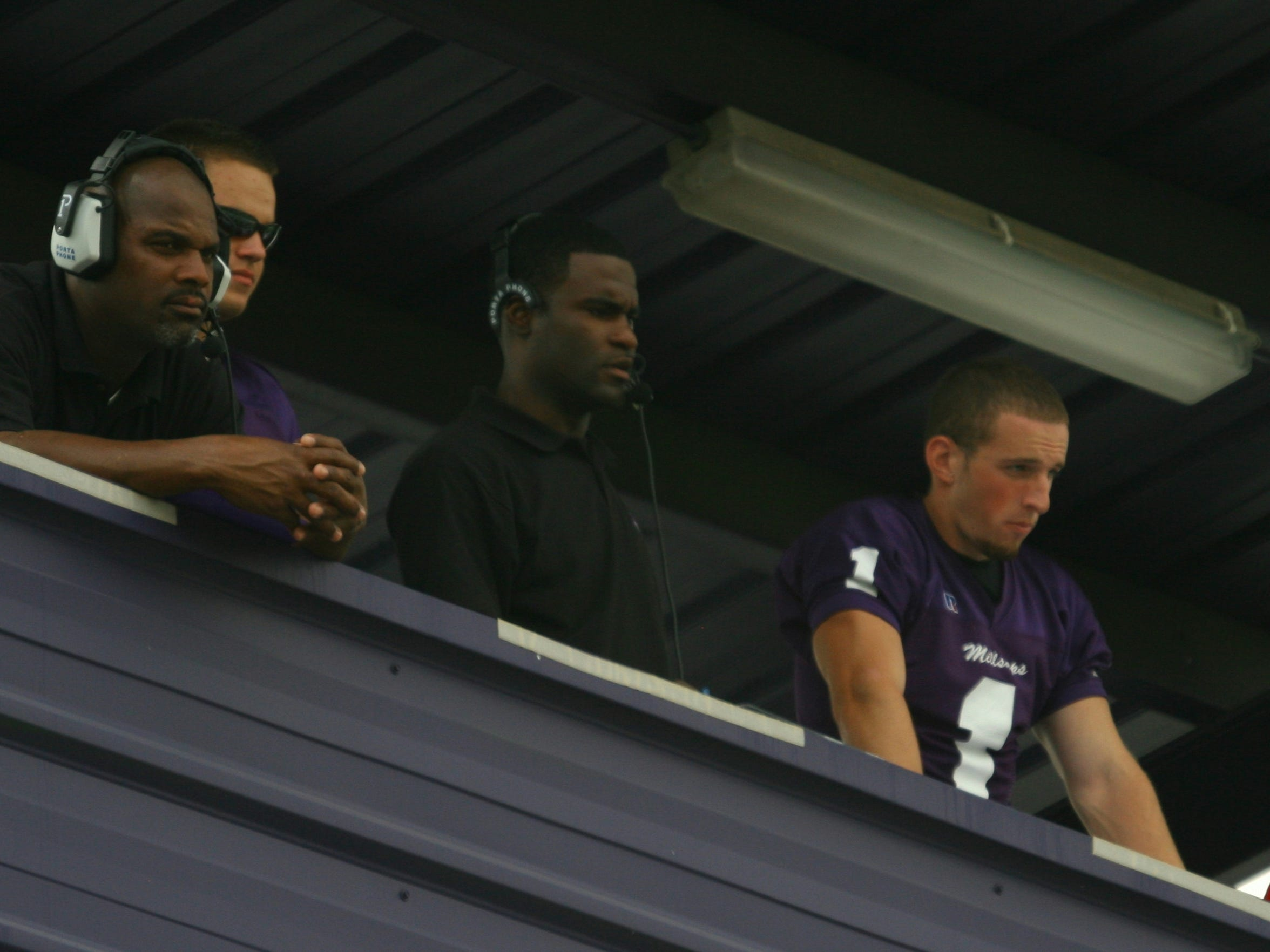 Fred McNair, left, shares the coaches box with Marcus