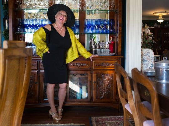 Joyce Bell wears Calvin Klein black knit dress; wide-brim black straw hat,  Chico's yellow silk quilted jacket and Michael Kors snakeskin and gold pumps.