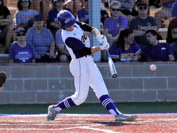 Wylie outfielder Brady Horn (9) collects one of his