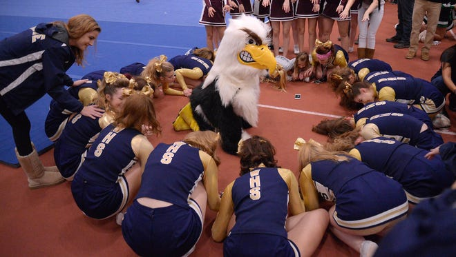 Wayne cheerleaders wait to hear their winning score, with some positive vibes provided by the squad from Lyons, top, during the Section 5 Fall Cheerleading Sectionals at RIT on Saturday, Oct. 29, 2016. Wayne took first place in Division 2 (Large Schools).