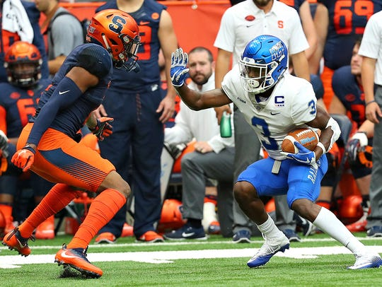 MTSU wide receiver Richie James looks to get past a