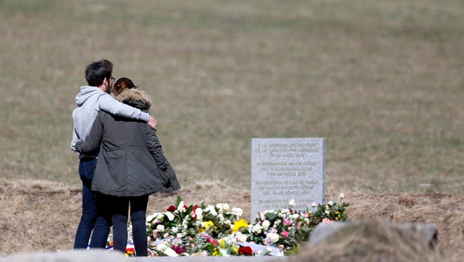 Relatives of the victims of the air crash visit the memorial in Le Vernet, southeastern  France, on March 30, 2015.
