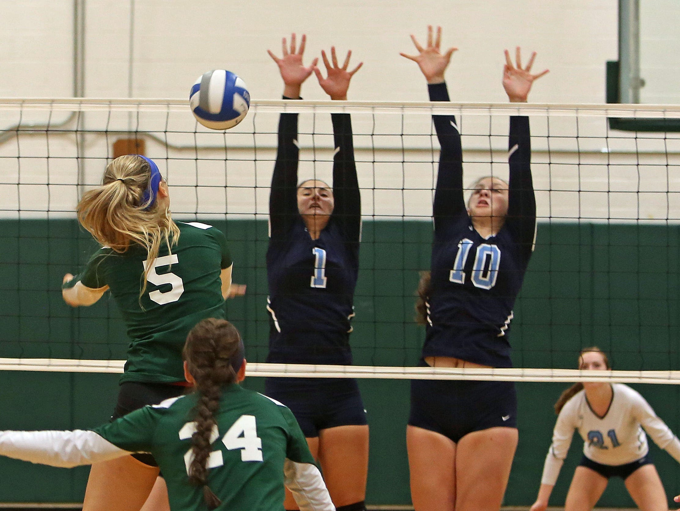 Westlake's Angelina Guarnieri (1) and Cayleigh Power (10) combine to stop a shot by Pleasantville's Chloe Violette (5) during volleyball action at Pleasantville High School Sept. 30, 2015.