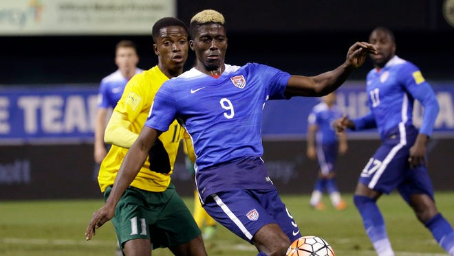 United States' Gyasi Zardes (9) challenges for the ball with St. Vincent and the Grenadines' Azinho Solomon during the second half of a 2018 World Cup qualifying soccer match Friday, Nov. 13, 2015, in St. Louis. The United States won 6-1.
