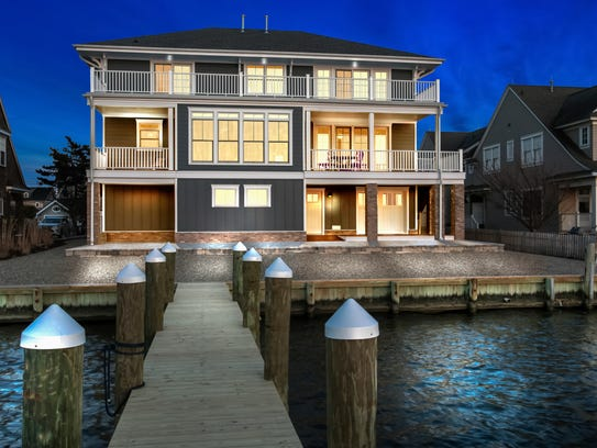 Back of home offers 75-foot pier.