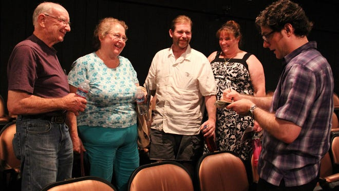 Arts and culture reporter Tom Mayhall Rastrelli (right) interviews the Wild family of Jefferson during the C.A.F.E. event at Pentacle Theatre on May 30.