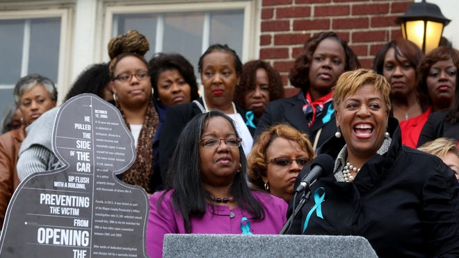 Wayne County prosecutor Kym Worthy and Kim Trent during a press conference outside of the Detroit Association of Women's Clubs in Detroit, Michigan on Tuesday, October 6, 2015. Worthy, Trent and other speakers were there to address the awareness of and the fundraising for the processing of rape kits. Over 50 woman stood together on the front yard to throw their support for the African American 490 Challenge. The coalition is asking for women to raise money to fund the cost to process rape kits. They are in partnership with Enough SAID (Enough Sexual Assault In Detroit)