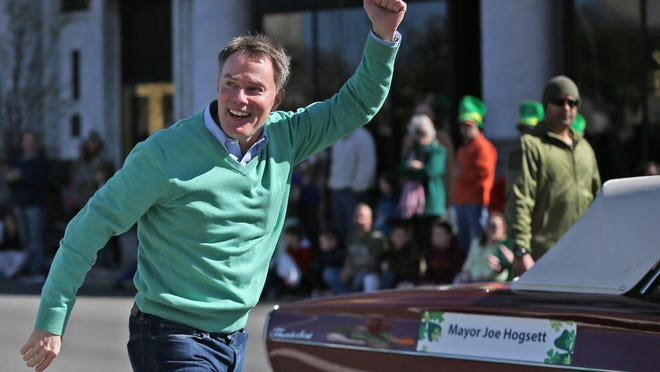 Mayor Joe Hogsett gives a thumbs up as he participates in the St. Patrick's Day Parade.