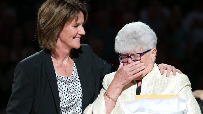 Indiana Fever head coach Lin Dunn, right, reacts to having a banner with her name raised to the rafters of Bankers Life Fieldhouse with team president Kelly Krauskopf before the game against the Chicago Sky, on Saturday, August 16, 2014, in Indianapolis.
