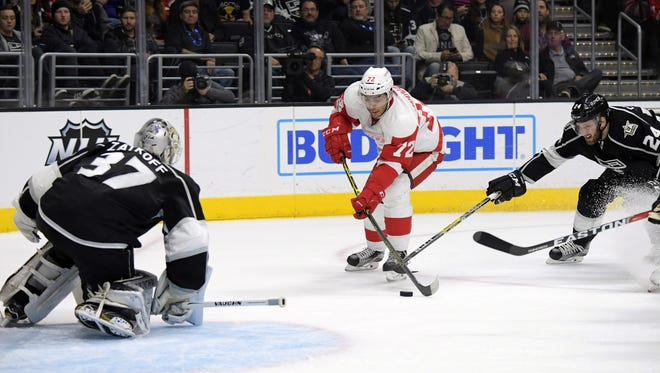 Jan 5, 2017; Los Angeles, CA, USA; Red Wings center Andreas Athanasiou takes a shot against Los Angeles Kings goalie Jeff Zatkoff in the first period at Staples Center.
