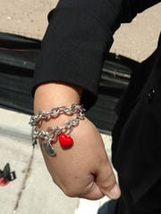 El Pasoan Lupe Amaya wears a charm in honor of her missing daughter, as well as charms for her four other children.