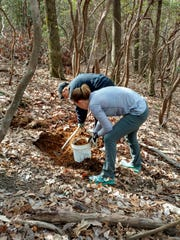 Annette Christopher, and Abby Harris work on trail maintenance in March with the new N.C. Mountain Trail Runners Club, a group to organize trail runners for group runs and trail maintenance work.