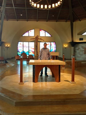 The Rev. Frank Lopez stands at the altar of the new St. Frances Xavier Cabrini Catholic Church.