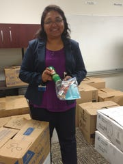 Syeda Nargis, from the Public Health Department, holds a Zika prevention kit, which outreach workers will be distributing to pregnant and nonpregnant women at WIC clinics and in colonias.