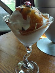 Homemade vanilla ice cream, topped with caramel sauce,