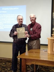 David McCaghren (right), president of the Kiwanis Club of Greater Abilene, presents an award to Joseph Marshall recognizing his 60 years of membership.