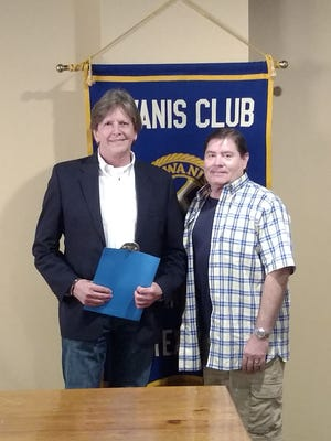 Tom Roberson is welcomed into the Kiwanis Club of Greater Abilene by his sponsor, Vance Cooksey.