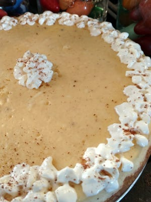 This eggnog cheesecake is a perfect dessert for a holiday party.