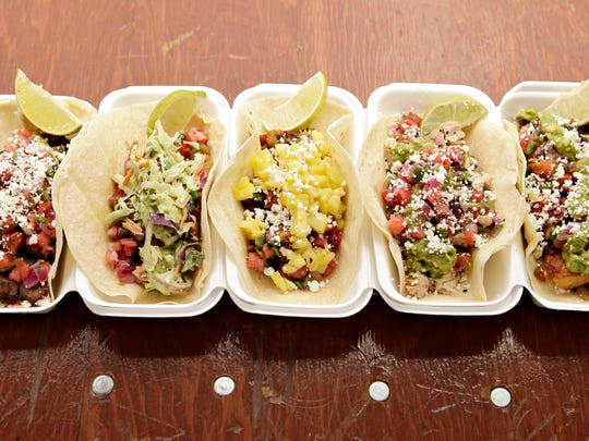 The taco lineup at Brushfire Tacos y Tapas in Peoria features (from left) steak, shrimp, pork, grilled chicken and veggie.