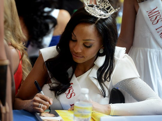 Miss Tennessee Soybean Festival Sarah Yarbrough signs autographs for fans at the Miss Tennessee 2016 contestant meet-and-greet Sunday at Old Hickory Mall.