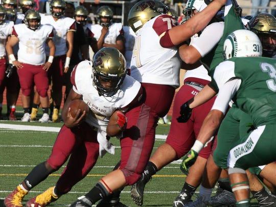 El Dorado quarterback Cedarious Barfield keeps the