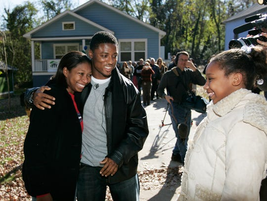 Warrick Dunn, whose Homes for the Holidays program