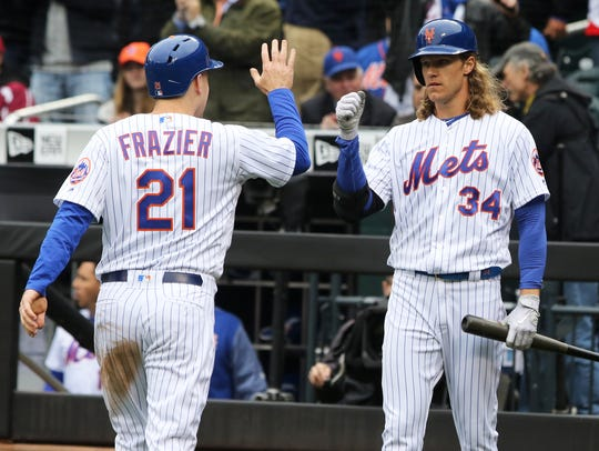 Todd Frazier is met at home by Noah Syndergaard after