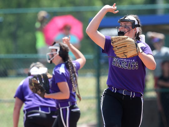 Clarksville's Taylor Adkins (right) cheers with the outfield during the 2016 TSSAA Class AAA State Softball Tournament consolation quarterfinal against Stewarts Creek  in Murfreesboro.